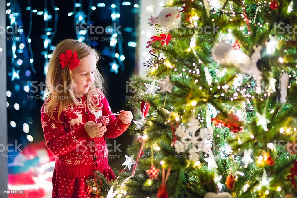 People Decorating For Christmas decorating the christmas tree pictures, images and stock photos