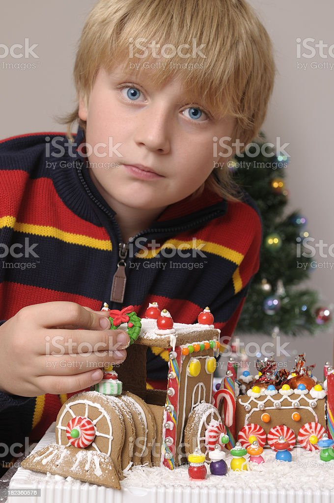 Child decorating gingerbread train royalty-free stock photo