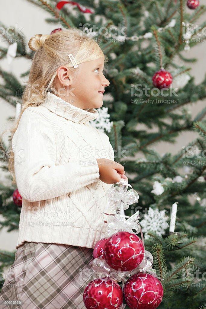 Child decorating the Christmas tree stock photo