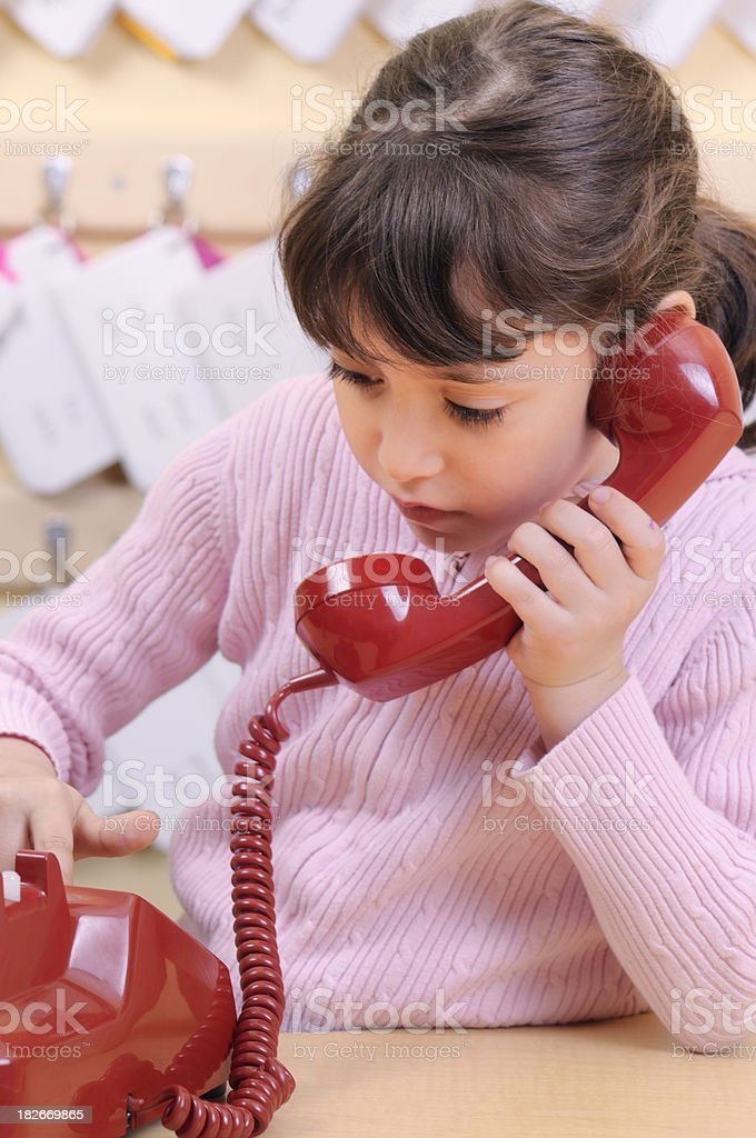 Child dialing number on red phone royalty-free stock photo