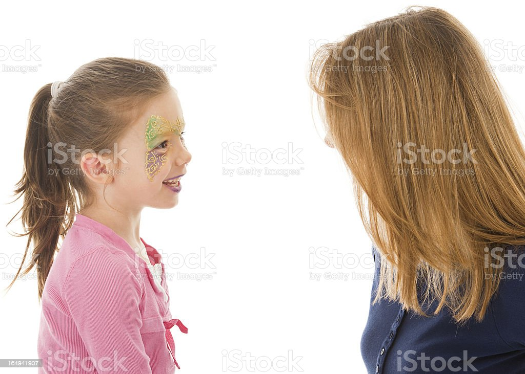 Child Discussing Face Paint with Artist stock photo