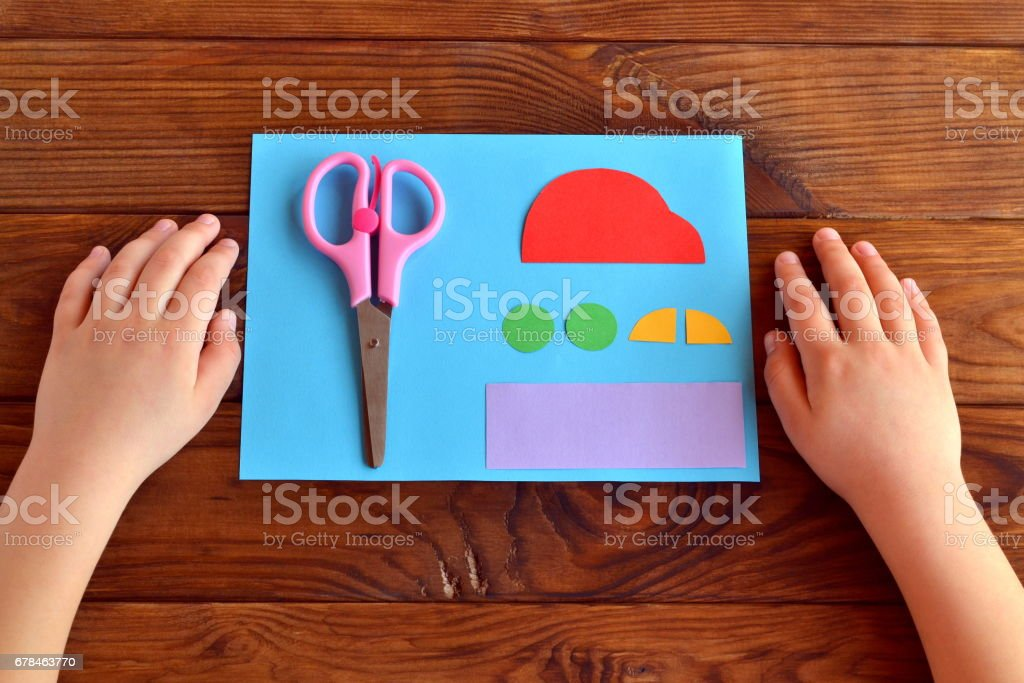Child does a greeting card father's day stock photo