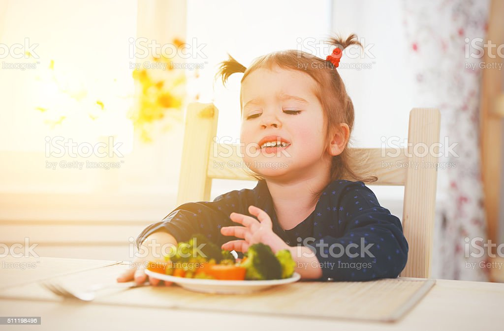 child does not like and not want to eat vegetables stock photo