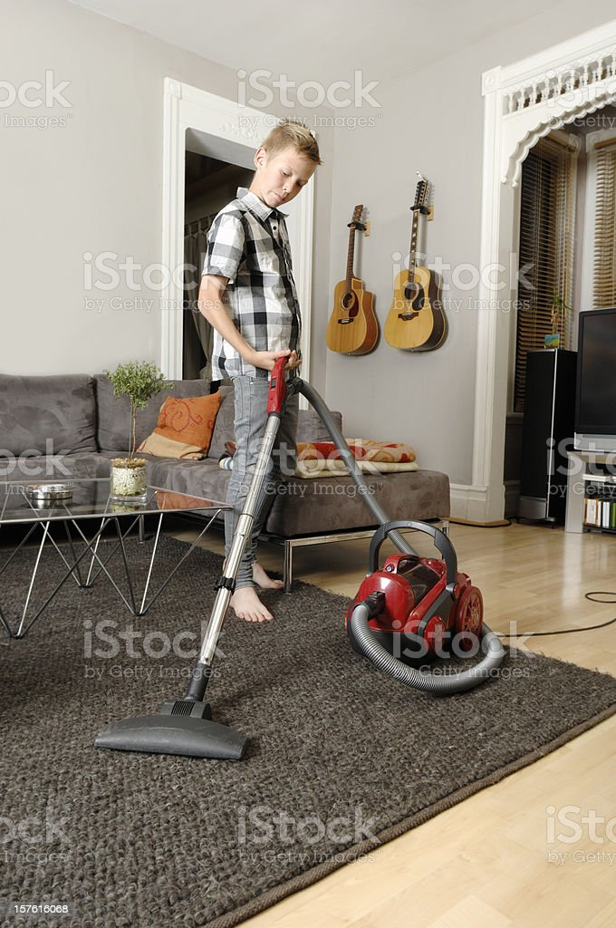 Child doing the vacuuming royalty-free stock photo