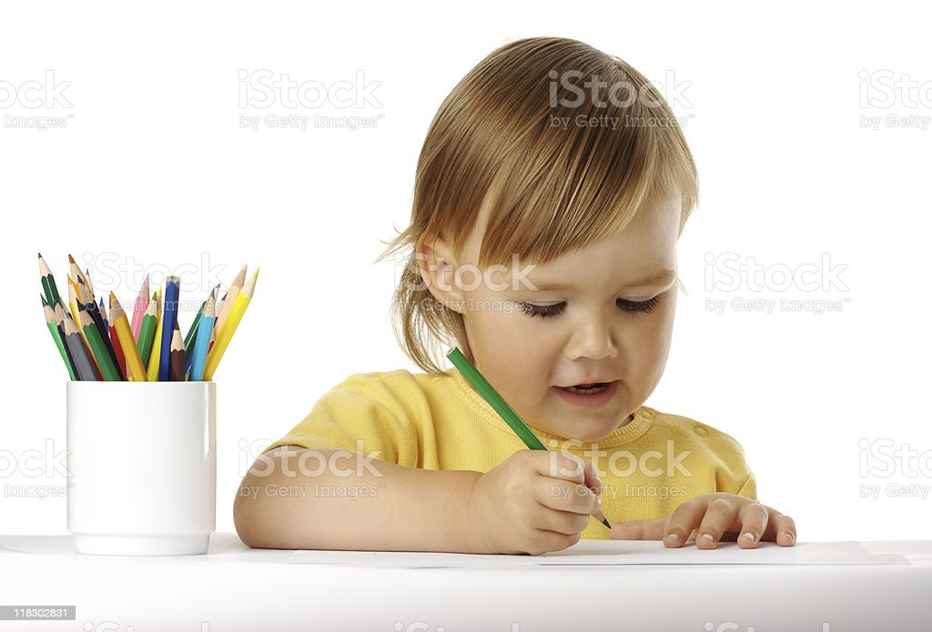 Child draw with green crayon stock photo