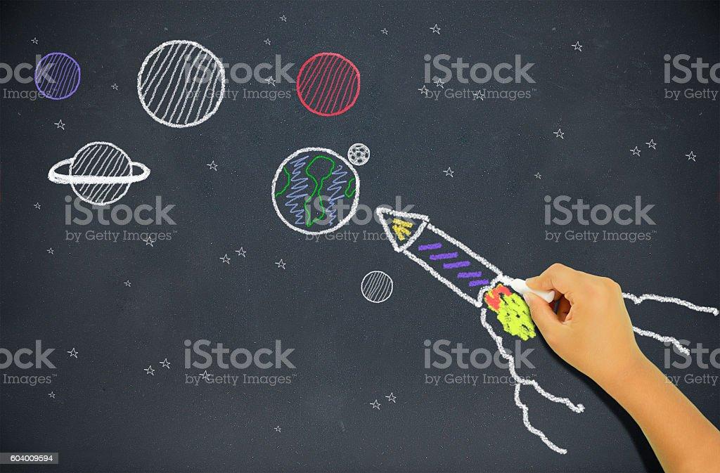 child drawing a rocket stock photo