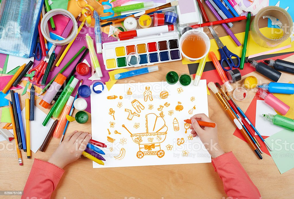 child drawing baby stuff - pram, wear and toys stock photo