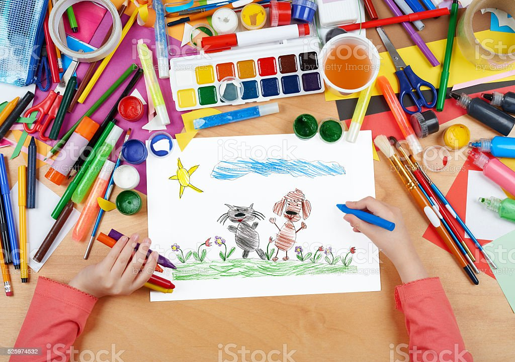 child drawing cat and dog friends walk on grass stock photo