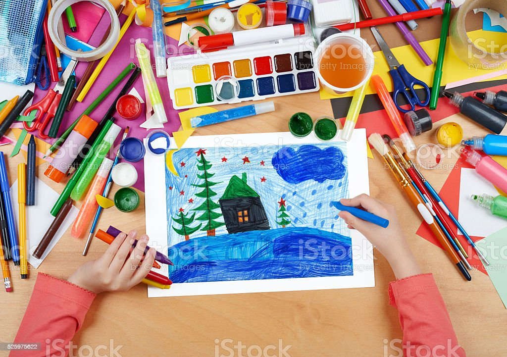 child drawing christmas night in forest with house stock photo