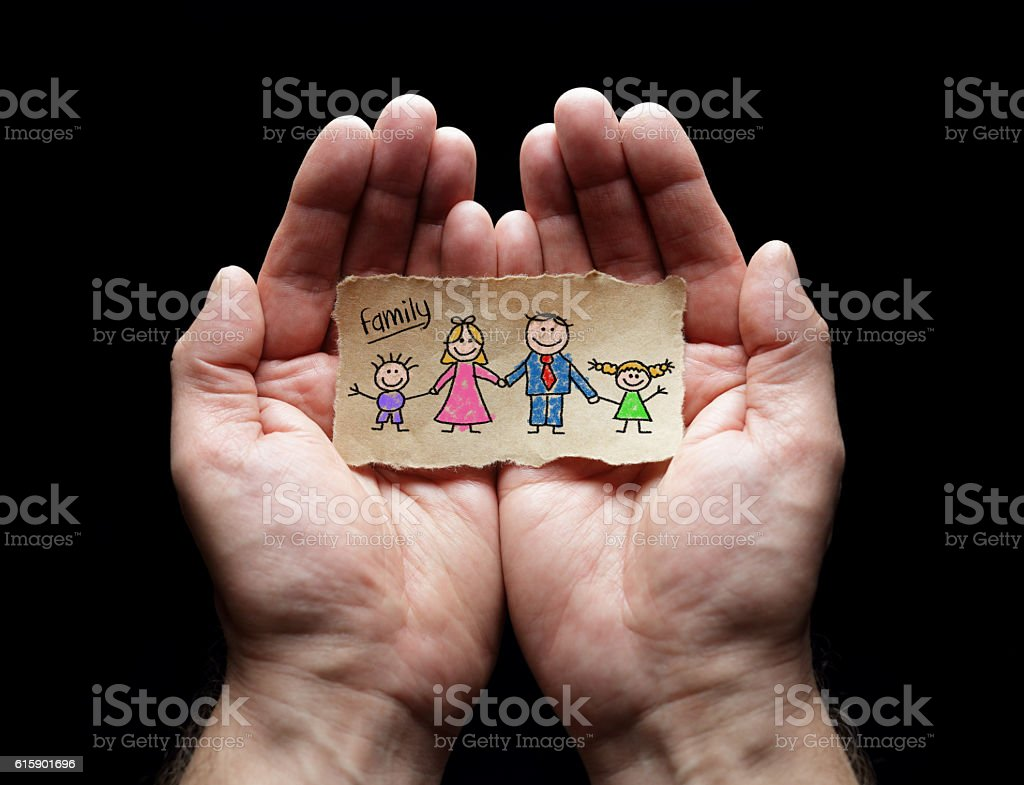 Child drawing of family with the protection of cupped hands stock photo