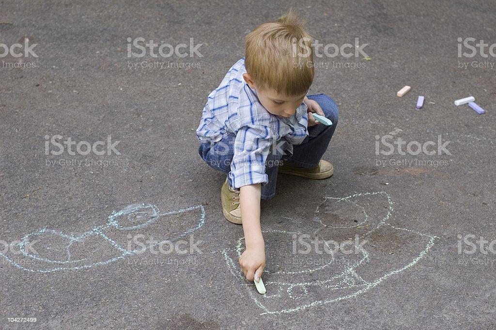 child drawing on asphalt car royalty-free stock photo