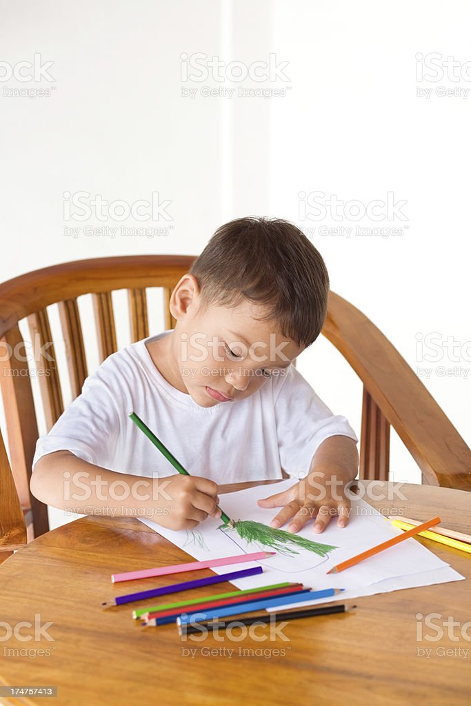 Child drawing on the table royalty-free stock photo