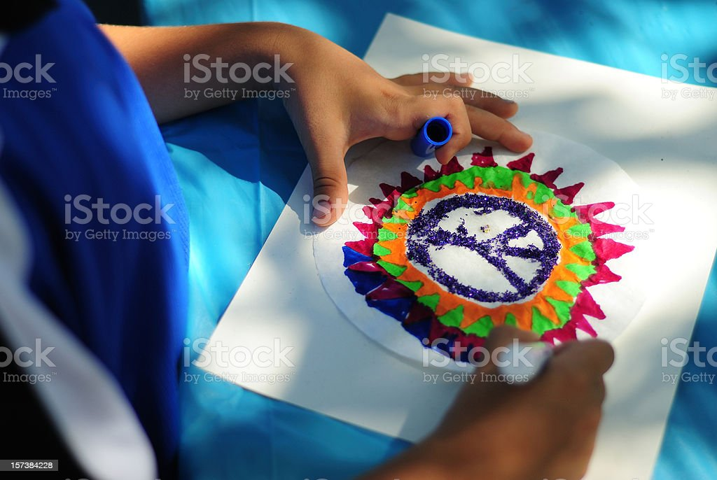 Child drawing peace sign royalty-free stock photo