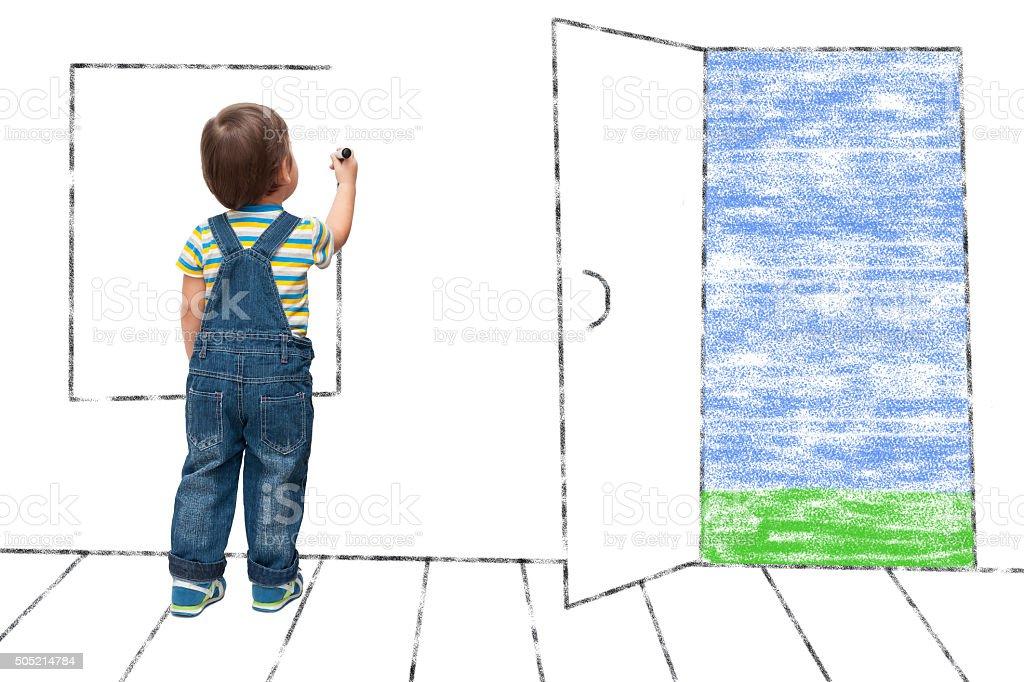 child draws an imaginary window stock photo