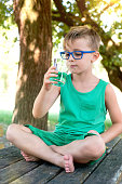 Child Drinking Green Drink