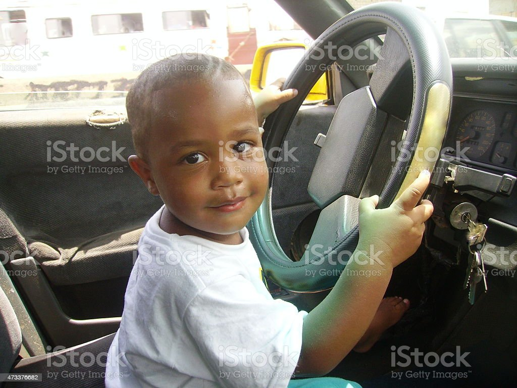 Child driving a car stock photo