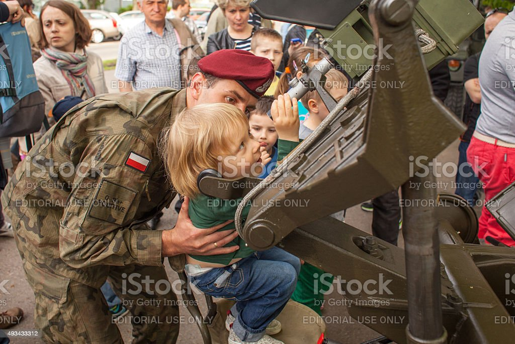 Child during demonstration of the military and rescue equipment stock photo