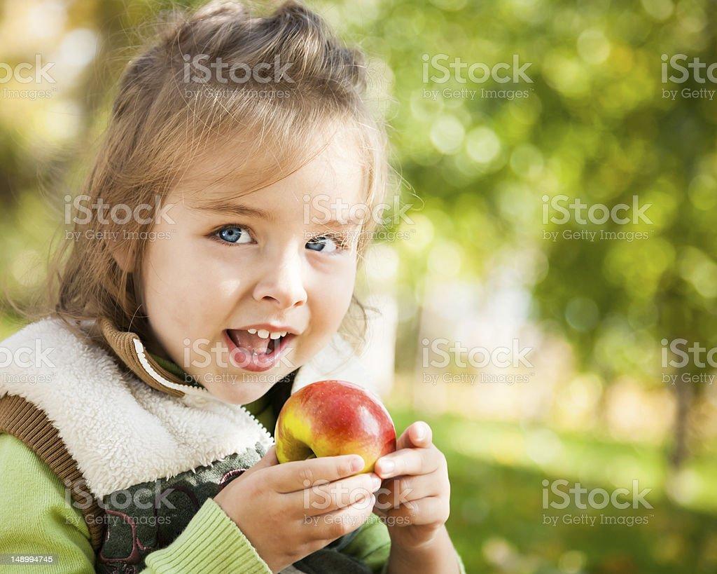 Child eating apple royalty-free stock photo