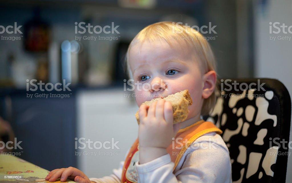 Child Eating Black Bread stock photo