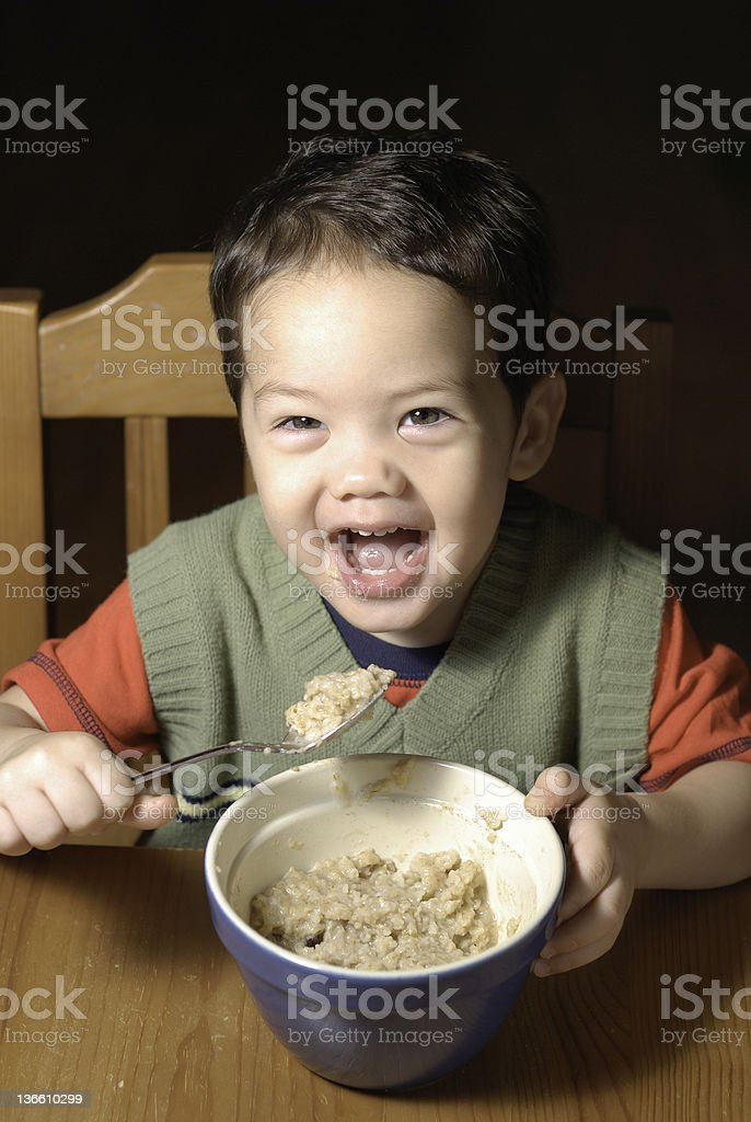 Child Eating His Oatmeal royalty-free stock photo