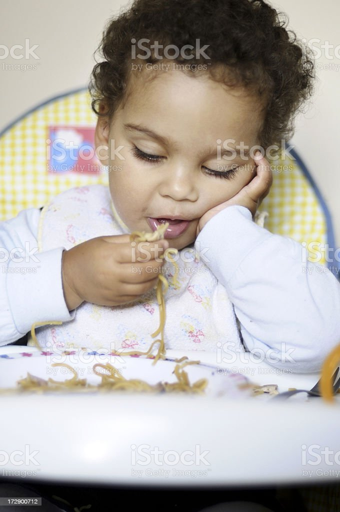 Child eating pasta royalty-free stock photo
