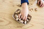 Child eating Peanuts