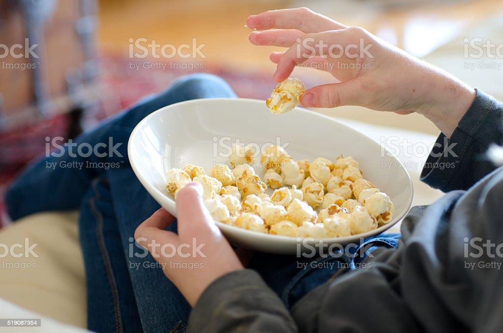 Child eating popcorn stock photo