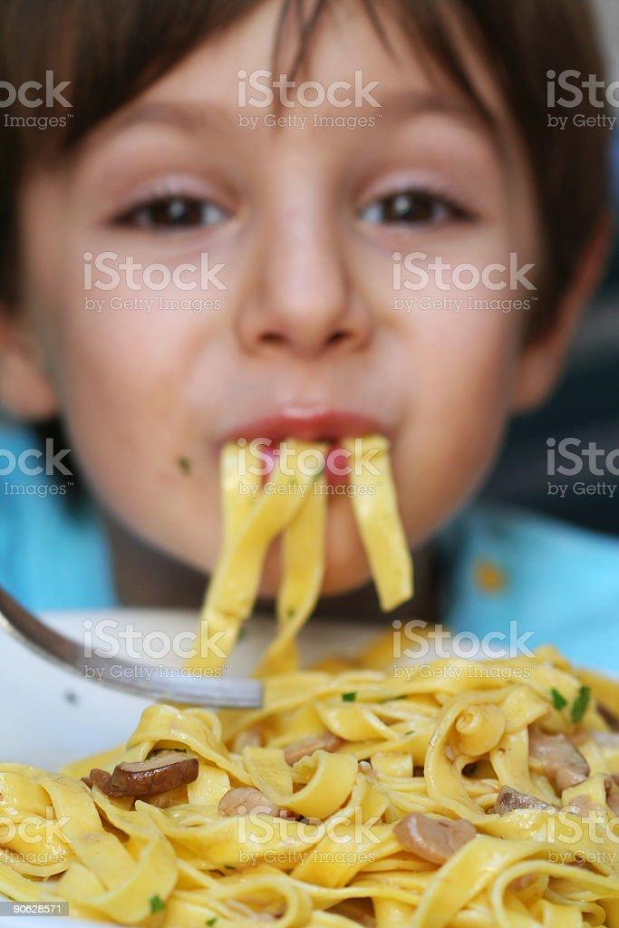 Child eating tagliatelle royalty-free stock photo