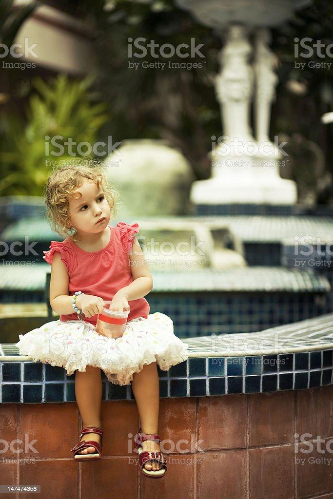 Child eats fruit crisps stock photo