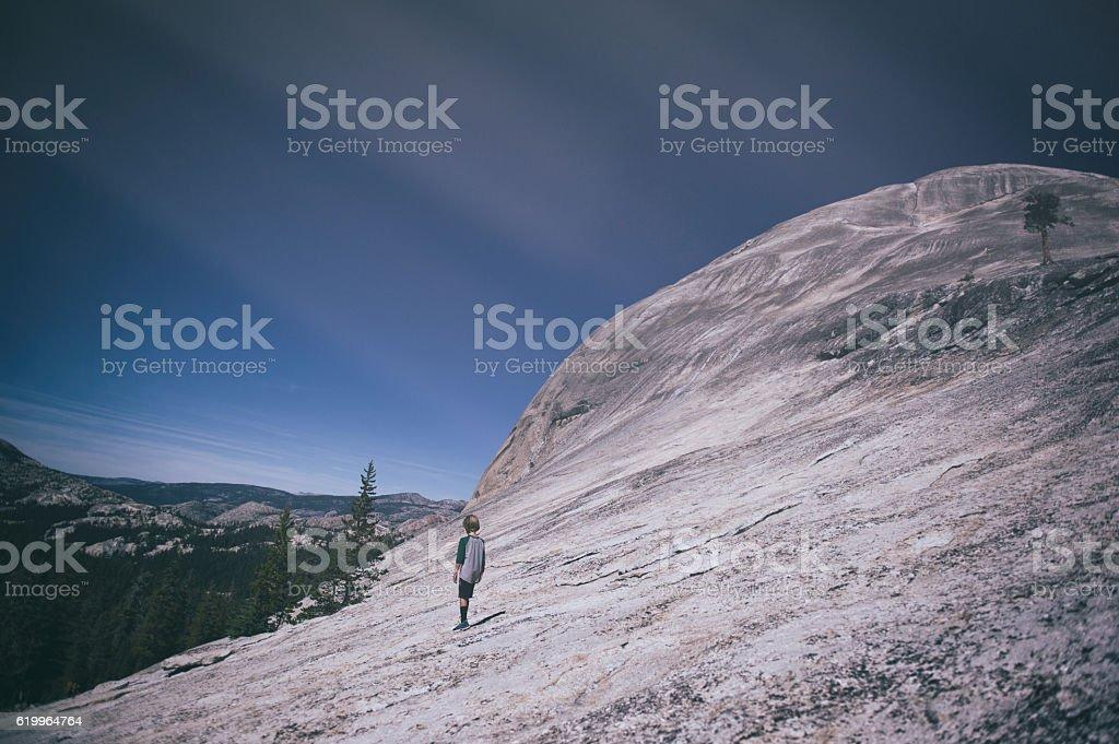 Child exploring alone in Tuolumne Meadows, Yosemite, California stock photo
