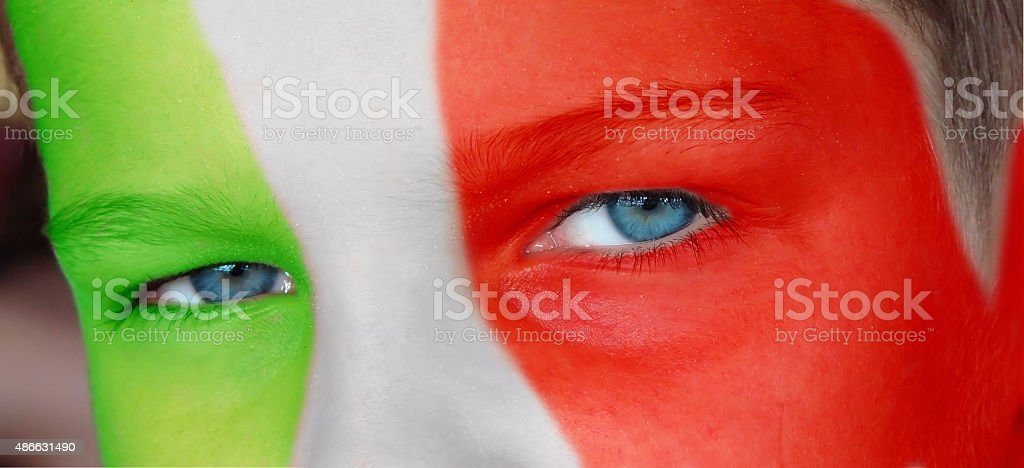 Child face with a painted italian flag stock photo