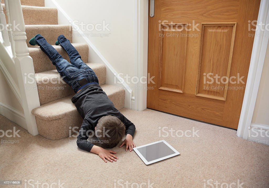 Child falling down the stairs stock photo