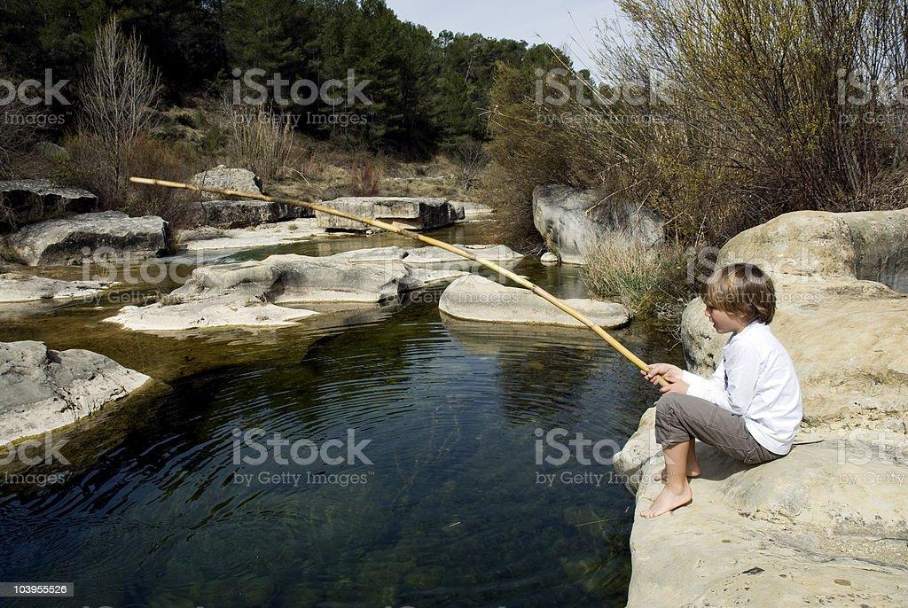 Child fishing stock photo