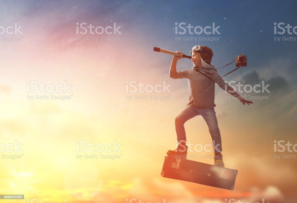Child flying on a suitcase stock photo