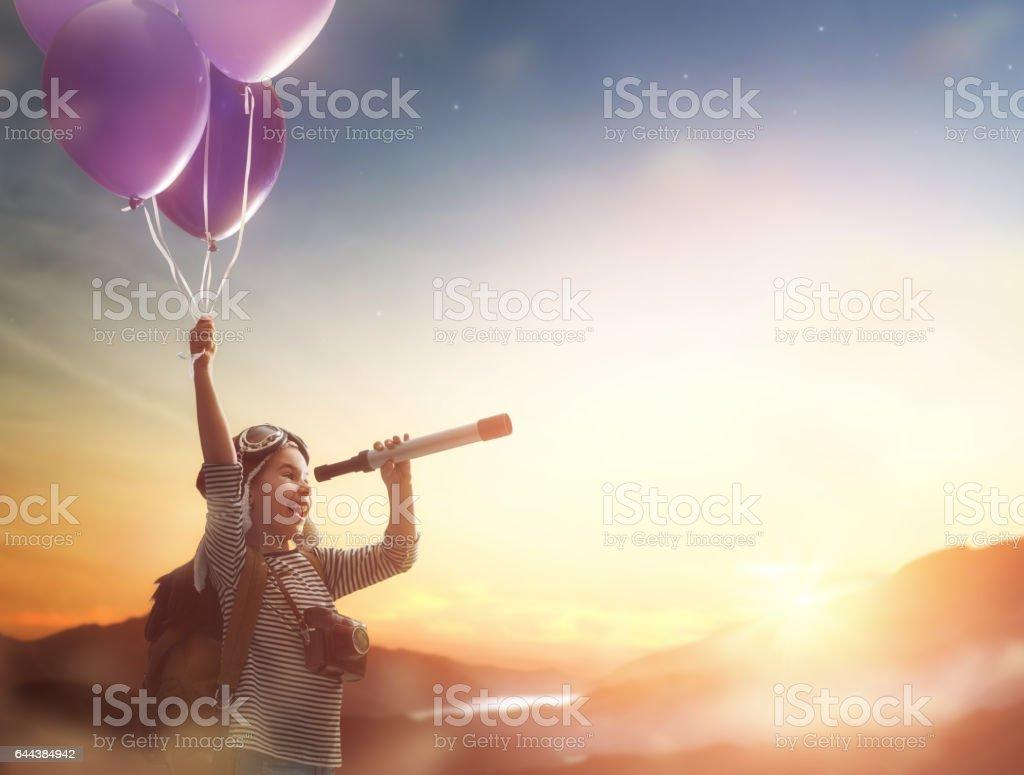 Child flying on balloons stock photo
