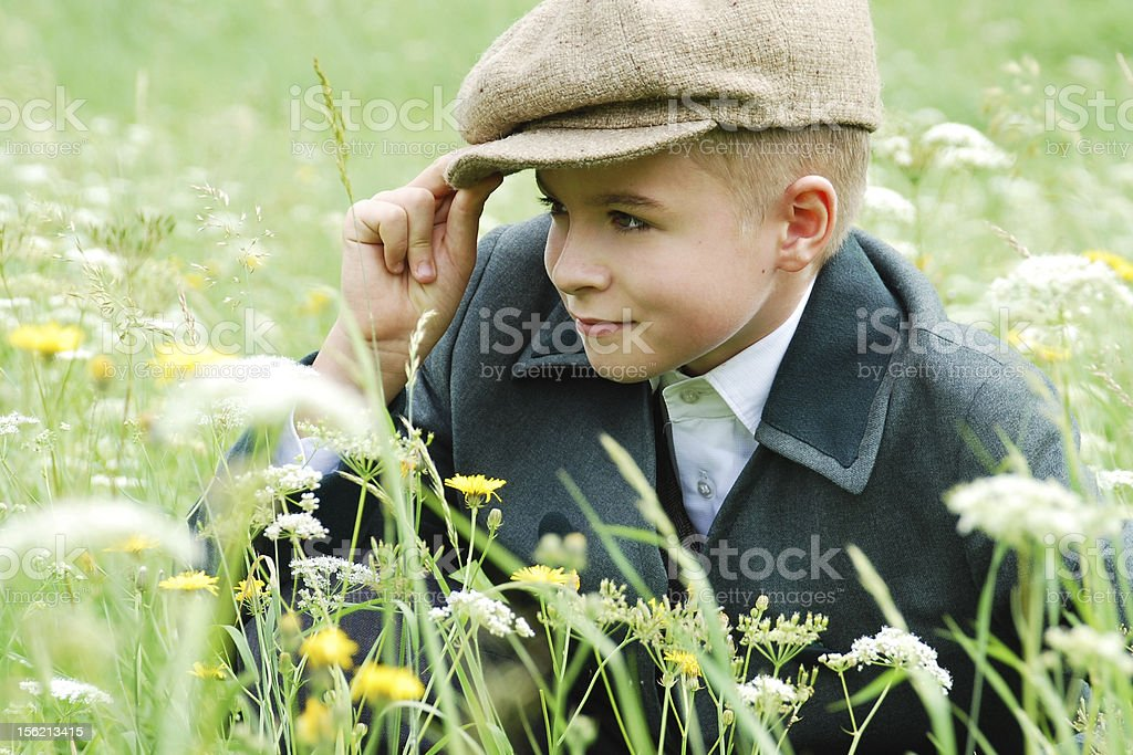 Child from other epoch in newsboy cap. stock photo