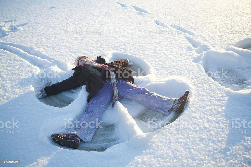 Child fun in snow at sunset stock photo