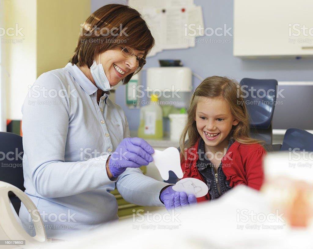 Child gets dental sticker stock photo