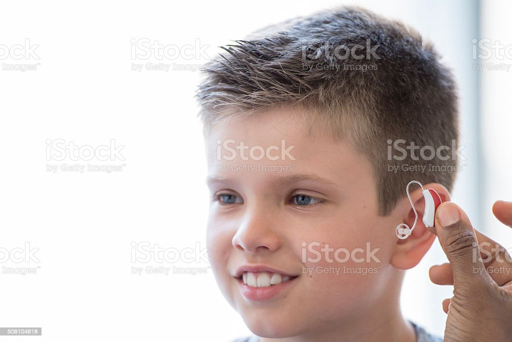Child Getting a Hearing Aid stock photo