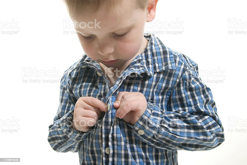 Child Getting Dressed (1) stock photo