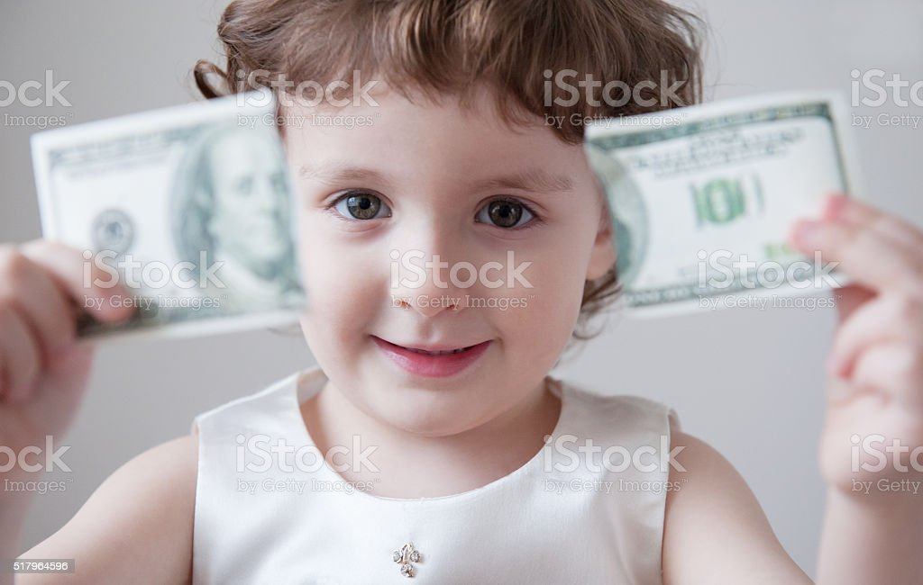 Child girl bank currency dollar finance system   break   unemployment crisis stock photo
