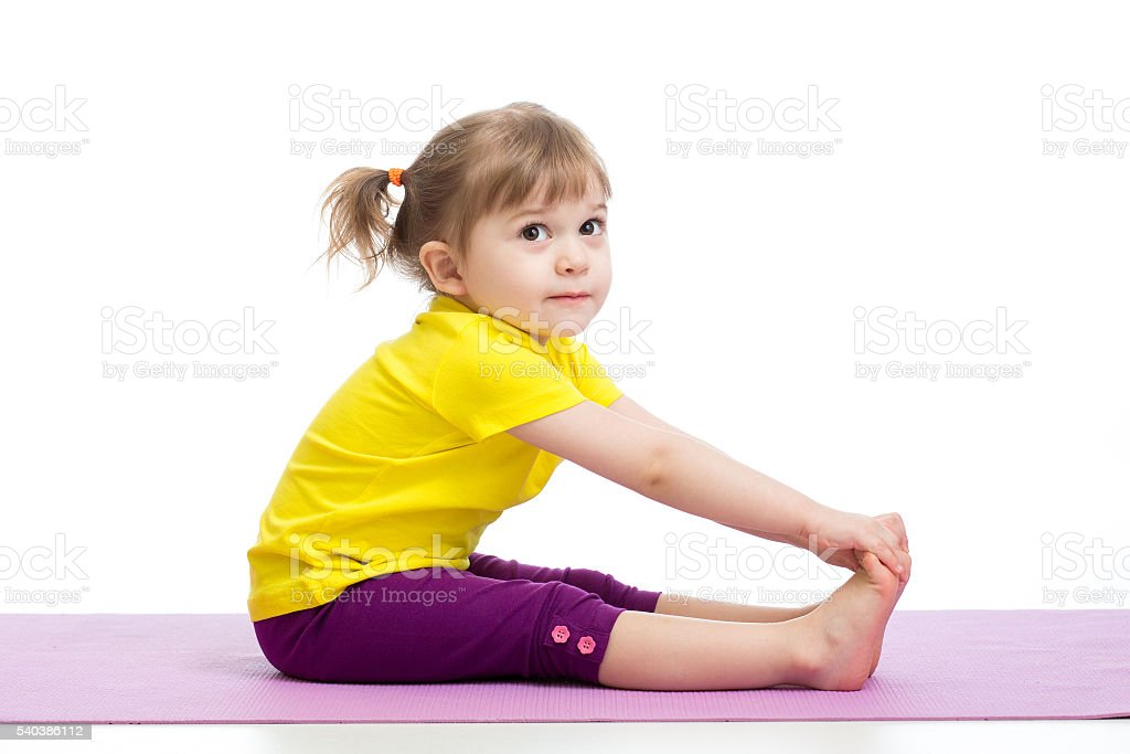 Child girl doing gymnastic exercises stock photo
