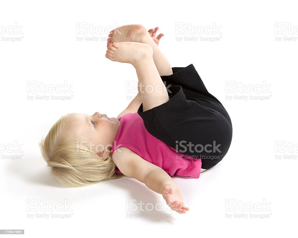 Child Girl Lying on Floor with Feet in Air royalty-free stock photo