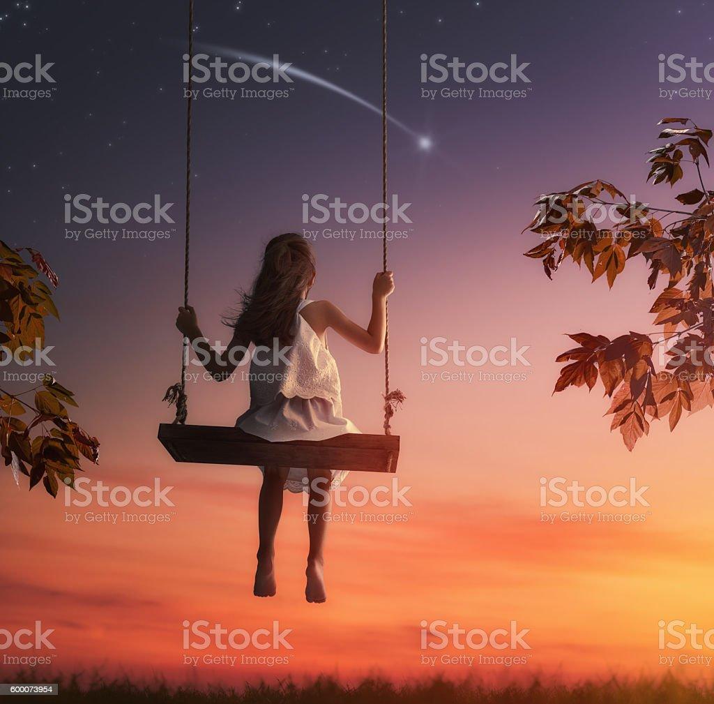 child girl on swing stock photo