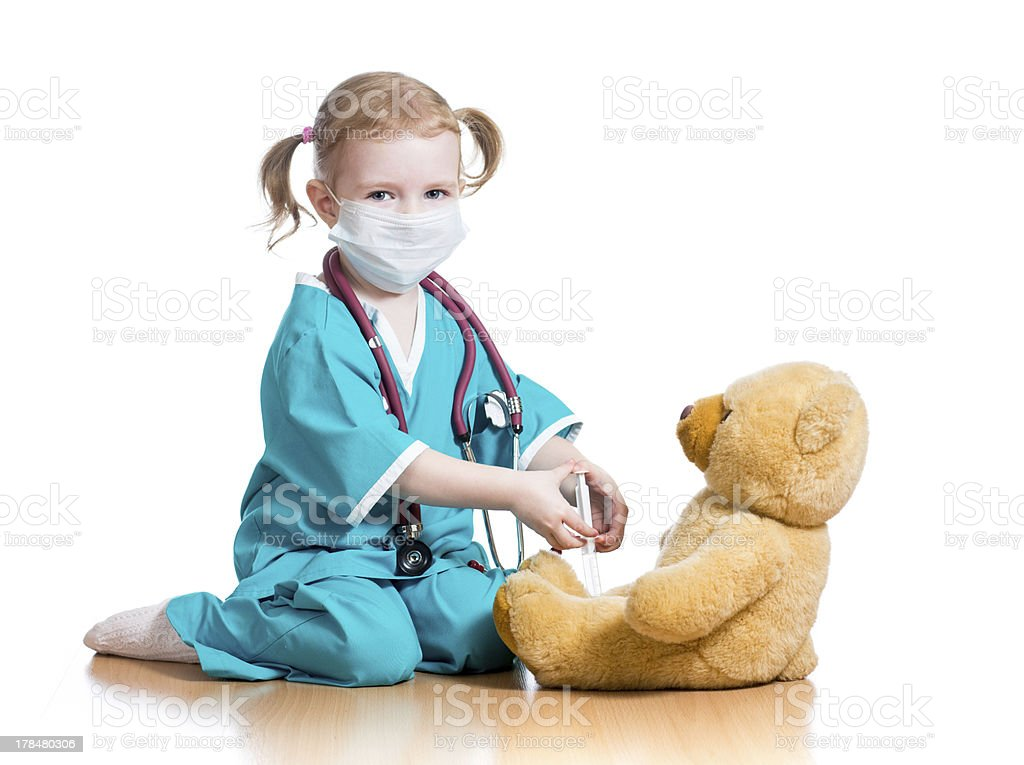 child girl playing doctor with toy stock photo