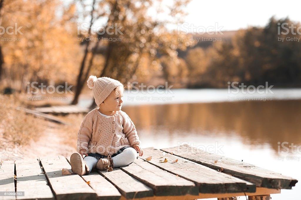 Child girl resting in park stock photo