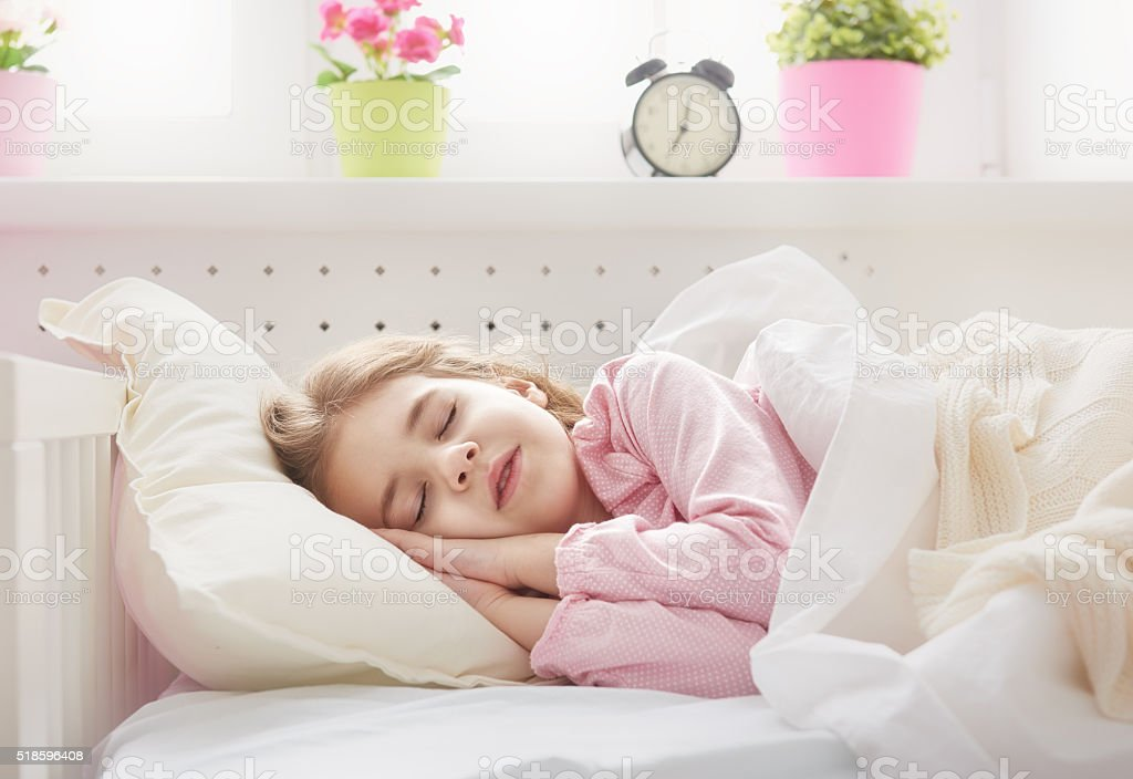 child girl sleeping stock photo