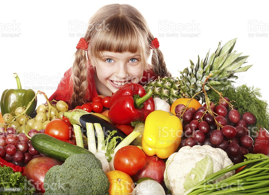 Child girl with group of vegetable and fruit. royalty-free stock photo