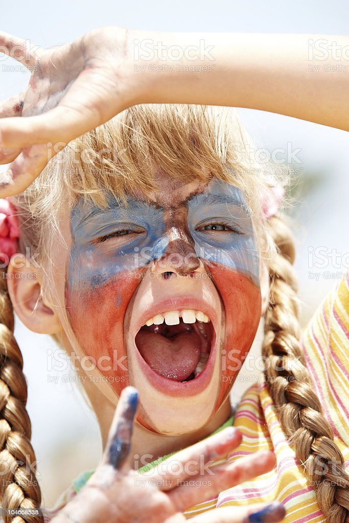 Child girl with paint on face and hand royalty-free stock photo