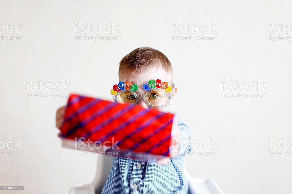 child gives a gift to someone stock photo